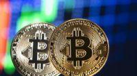 Bitcoin 9,000 doların üzerinde tutunuyor